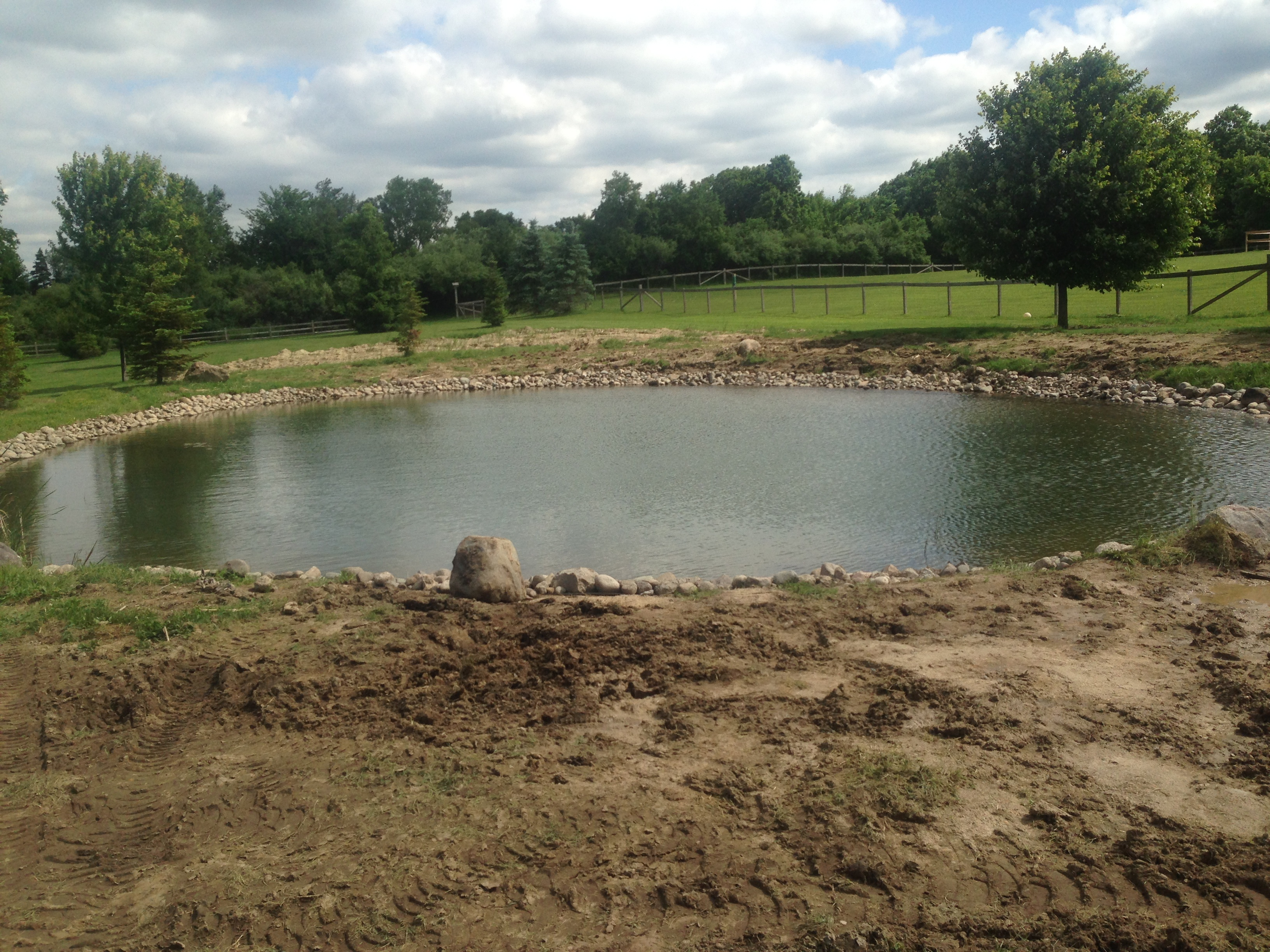 Backyard pond bank stabilization michigan howell for Design of stabilisation pond