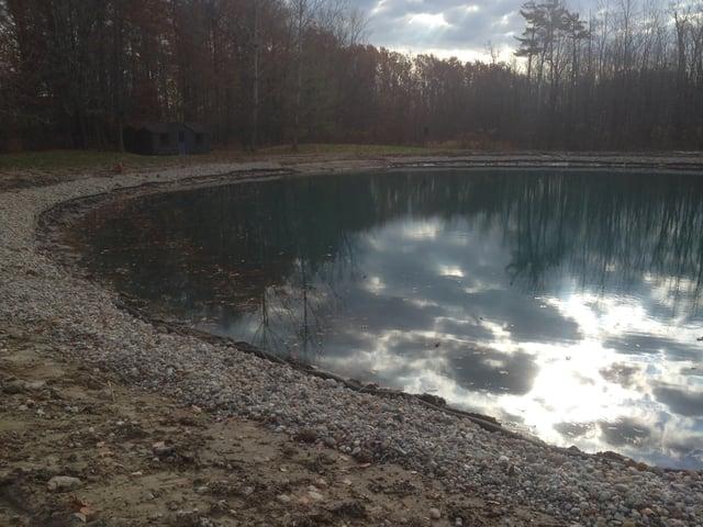 Rocks_around_pond_fix_pond_banks_Metamora_MI_21.jpg